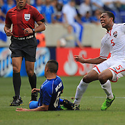 Carlyle Mitchell, Trinidad and Tobago, (right) is challenged by Richard Menjivar, El Salvador, during the El Salvador Vs Trinidad and Tobago CONCACAF Gold Cup group B football match at Red Bull Arena, Harrison, New Jersey. USA. 8th July 2013. Photo Tim Clayton