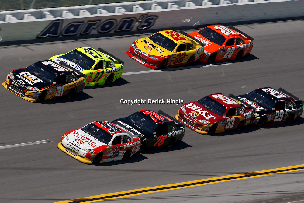 April 17, 2011; Talladega, AL, USA; NASCAR Sprint Cup Series drivers Dave Blaney (36), Regan Smith (78), Jeff Burton (31), Paul Menard (27), Clint Bowyer (33), Kevin Harvick (29), Kurt Busch (22) and Joey Logano (20) during the Aarons 499 at Talladega Superspeedway.   Mandatory Credit: Derick E. Hingle