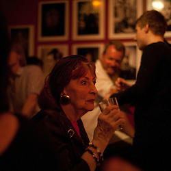 Manchester, UK - 4  August 2012: a senior woman sips her drink while listening to live music at the Matt & Phreds, most known for showcasing some of the the best Jazz in town