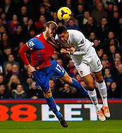 Glenn Murray of Crystal Palace and Chris Smalling of Manchester United in an aerial battle during the Barclays Premier League match at Selhurst Park, London<br /> Picture by David Horn/Focus Images Ltd +44 7545 970036<br /> 22/02/2014