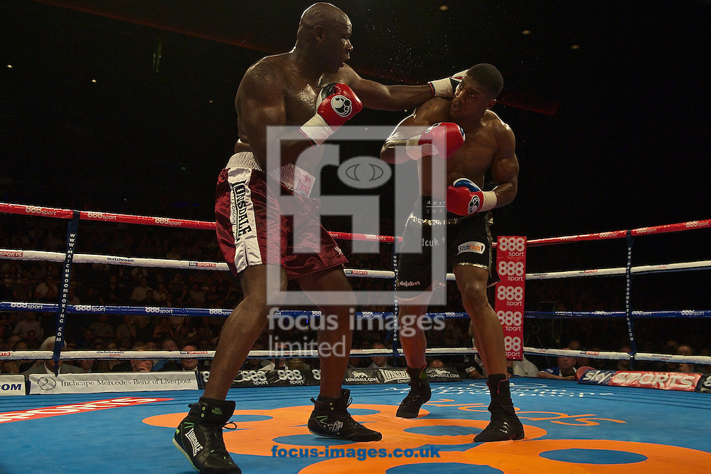 Anthony Joshua (black shorts) v Matt Skelton (burgundy shorts)<br /> during their heavyweight contest at Echo Arena, Liverpool<br /> Picture by Ian Wadkins/Focus Images Ltd +44 7877 568959<br /> 12/07/2014