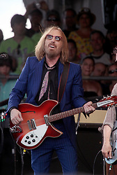28 April 2012. New Orleans, Louisiana,  USA. .New Orleans Jazz and Heritage Festival. .Tom Petty takes to the Acura Stage - but not before closing the photo pit to photographers excepting the select few with deals to shoot..Photo; Charlie Varley.