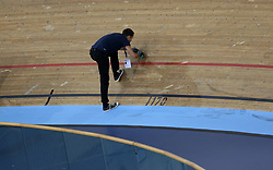 Track staff make repairs after riders collided during the Men's Omnium Scratch Race 1/4 during day three of the Tissot UCI Track Cycling World Cup at Lee Valley VeloPark, London.