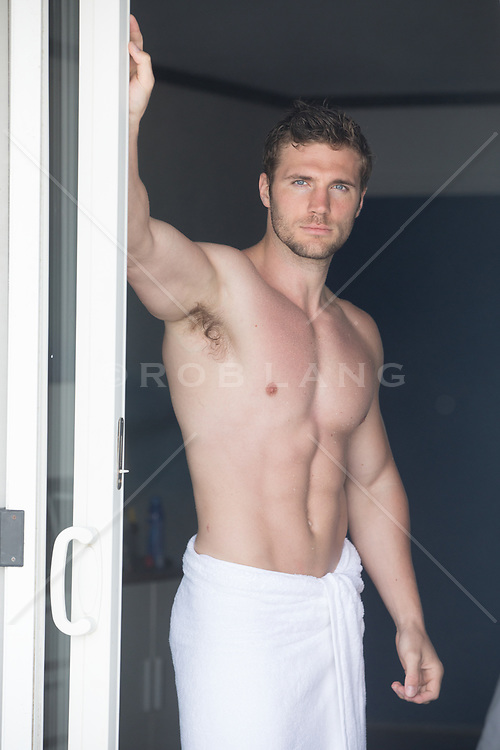 shirtless muscular man in a doorway