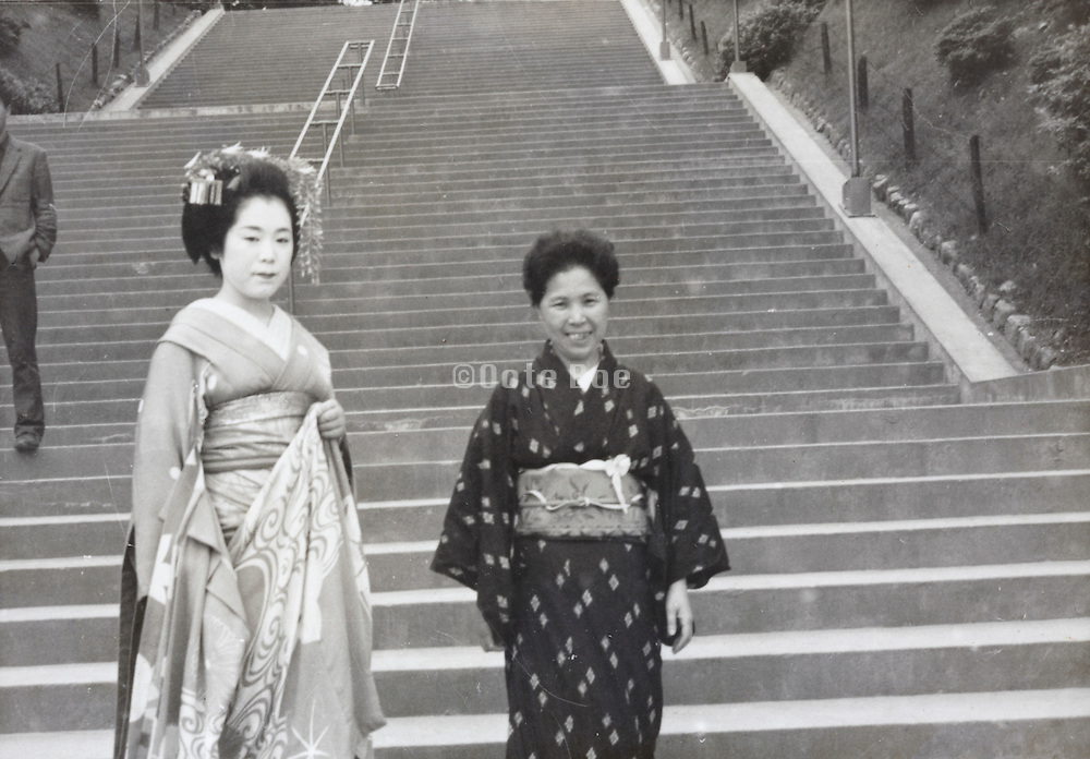 Maiko posing with Japanese tourist in Japan 1950s 1960s