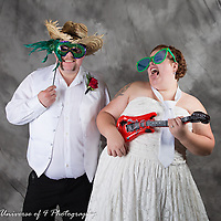 "Bride and groom rocking the photo booth. They are enjoying our ""open air"" photo booth. This is included in all of our wedding packages. Your guest can have free formals and lots of fun!! Everyone gets involved."