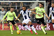 West Bromwich Albion midfielder Matt Phillips (10) battles for possession  with Sheffield United defender Richard Stearman (19) during the EFL Sky Bet Championship match between West Bromwich Albion and Sheffield United at The Hawthorns, West Bromwich, England on 23 February 2019.