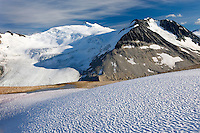 Icemaker Mountain (left) 2745 m (9006 ft) and Mount Guthrum 2695 m (8842 ft) seen from snow covered slopes above Athelney Pass, Coast Mountains British Columbia Canada