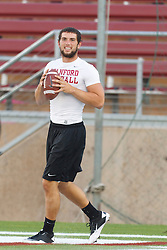 Oct 1, 2011; Stanford CA, USA;  Stanford Cardinal quarterback Andrew Luck (12) warms up before the game against the UCLA Bruins at Stanford Stadium. Stanford defeated UCLA 45-19. Mandatory Credit: Jason O. Watson-US PRESSWIRE