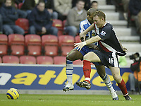 Photo: Aidan Ellis.<br /> Wigan Athletic v West Bromwich Albion. The Barclays Premiership. 15/01/2006.<br /> Wigan's Jason Roberts battles with West Brom's Steve Watson