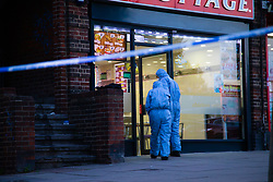 Police and forensic investigators attend the scene of yet another London shooting, thistle outside a Chicken Cottage outlet adjacent to Rayners Lane Underground Station. Rayners Lane, London, August 21 2018.