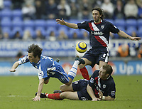 Photo: Aidan Ellis.<br /> Wigan Athletic v West Bromwich Albion. The Barclays Premiership. 15/01/2006.<br /> Wigan's Leighton Baines is tackled by West Brom's Steve Watson