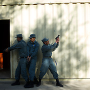 November 14, 2012 - Kabul, Afghanistan: Afghan National Police (ANP) cadets simulate a raid to a Taliban house during combat exercises at the Afghan Nacional Police Academy...ANP Academy trains 1250 cadets at the time during a period of four years. Every year, five hundred new recruits are selected, out of more than nine thousand of candidates, to join the academy and other five hundred graduate. Fifteen per cent of the recruits are women. (Paulo Nunes dos Santos)