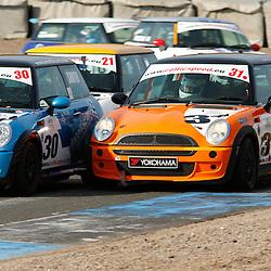 KNOCKHILL Scottish Motor Racing Club meetingl...William Smith pushes past John Finlayson in the celtic speed scottish mini cooper cup race ....(c) STEPHEN LAWSON | StockPix.eu