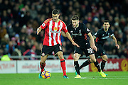 Sunderland midfielder Jack Rodwell (#8) holds on the challenge of Liverpool midfielder Adam Lallana (#20) during the Premier League match between Sunderland and Liverpool at the Stadium Of Light, Sunderland, England on 2 January 2017. Photo by Craig Doyle.
