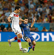 Germany's Mats Hummels and Argentina's Sergio Aguero during the 2014 FIFA World Cup Final match at Maracana Stadium, Rio de Janeiro<br /> Picture by Andrew Tobin/Focus Images Ltd +44 7710 761829<br /> 13/07/2014