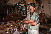 June 14, 2011; Minamisanriku, Miyagi Pref., Japan - Mr. Yoyotaro Suzuki stands in the room on the third floor of a reception hall where he was enjoying a wedding party just before the magnitude 9.0 Great East Japan Earthquake and Tsunami that devastated the Tohoku region of Japan on March 11, 2011...He and all the guests evacuated to the 4th floor and survived the tsunami which wiped out 80% of Minamisanriku.