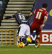Picture by David Horn/Focus Images Ltd +44 7545 970036<br /> 03/12/2013<br /> Lee Martin of Millwall is tackled fairly in the box by Andy Reid of Nottingham Forest accoring to the referee during the Sky Bet Championship match at The Den, London.