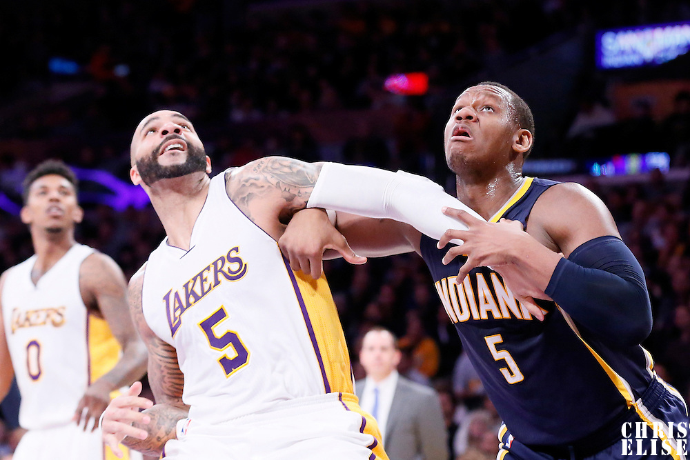 04 January 2014: Los Angeles Lakers forward Carlos Boozer (5) vies for the rebound with Indiana Pacers forward Lavoy Allen (5) during the Los Angeles Lakers 88-87 victory over the Indiana Pacers, at the Staples Center, Los Angeles, California, USA.