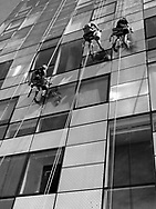 Window washers at work at a building along the Highline Park in New York City.