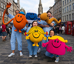 Edinburgh, Scotland, UK. 15 August 2019. Warm sunny weather in Edinburgh brought thousands of tourists onto the Royal Mile to enjoy the many street performers and actors promoting their shows during the Edinburgh Festival Fringe. Pictured. Mr Men and Little Miss cast. Iain Masterton/Alamy Live News ++ Editorial Use Only ++