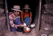 Preparing guinea pig (cuy) feast.Cuzco department, Peru