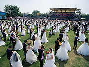 HANGZHOU, CHINA - APRIL 30: (CHINA OUT) <br /> <br /> Graduates couples attend the group wedding at Zhejiang University on April 30, 2016 in Hangzhou, Zhejiang Province of China. Over 400 couples of graduates came back to Zhejiang University to get married together on Saturday<br /> ©Exclusivepix Media
