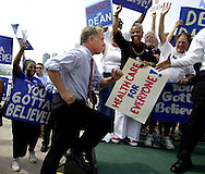 Democratic Presidential candidate Former Gov. Howard Dean (Vt) runs up onto the stage as he gets ready to speak at a rally at Navy Pier Tuesday August 26, 2003 in Chicago, Ill.  Before the rally he spoke to the Communication Workers of America convention being held at the pier.