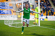 Christian Doidge (#9) of Hibernian FC runs off to celebrate after scoring Hibs fourth goal to give him a hat-trick during the Ladbrokes Scottish Premiership match between St Johnstone FC and Hibernian FC at McDiarmid Park, Perth, Scotland on 9 November 2019.