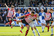 Early chance for Exeter as Exeter City's Jordan Moore-Taylor takes a shot during the Sky Bet League 2 match between Bristol Rovers and Exeter City at the Memorial Stadium, Bristol, England on 23 April 2016. Photo by Shane Healey.