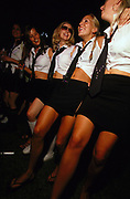 Row of girls dancing in the main tent at School Fields the School Disco all-dayer July 2002