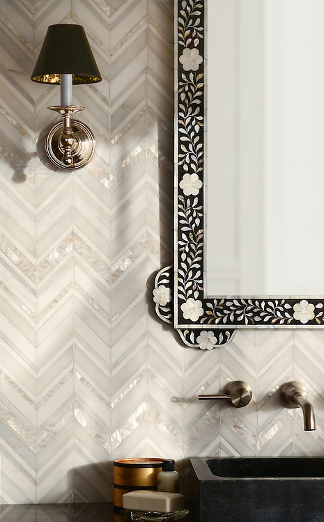 Magdalena, a handmade mosaic shown in polished Shell, Thassos, Dolomite and Afyon White, is part of the Aurora® collection by New Ravenna.