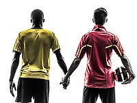 two men soccer player playing football competition hand in hand in silhouette on white background