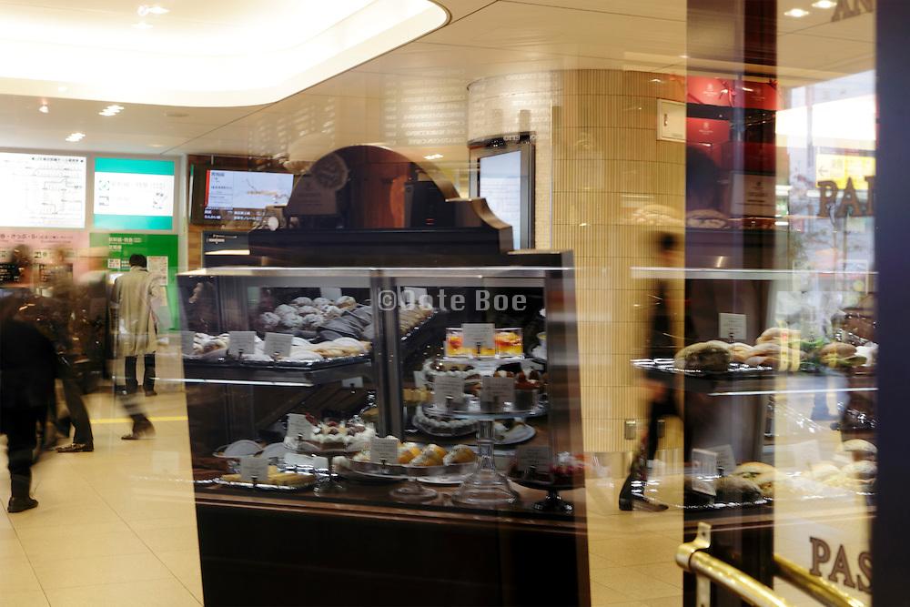 bakery display reflecting in window