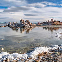 Early morning clouds and tufas reflect in still waters of Mono Lake, Lee Vining, California