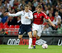 Photo: Richard Lane/Sportsbeat Images.<br />England v Germany. International Friendly. 22/08/2007. <br />England's David Beckham and Germany's Thomas Hitzlsperger challenge for the ball.