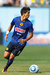 July 16, 2011; San Francisco, CA, USA;  Club America midfielder Jesús Molina (5) dribbles the ball against Manchester City during the first half at AT&T Park. Manchester City defeated Club America 2-0.