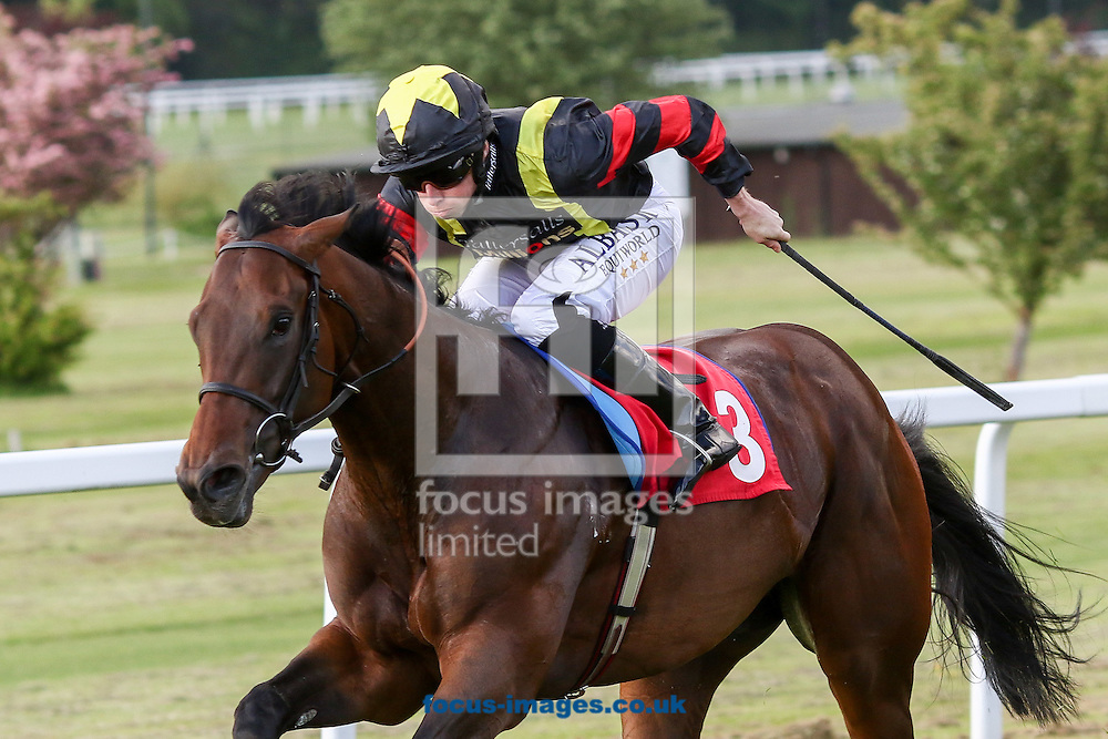 Global Applause ridden by Ryan Moore (Black, yellow braces) wins the BetVictor Million Pound Goal National Stakes during the Brigadier Gerard  meeting at Sandown Park, Esher. UK<br /> Picture by Mark Chappell/Focus Images Ltd +44 77927 63340<br /> 26/05/2016