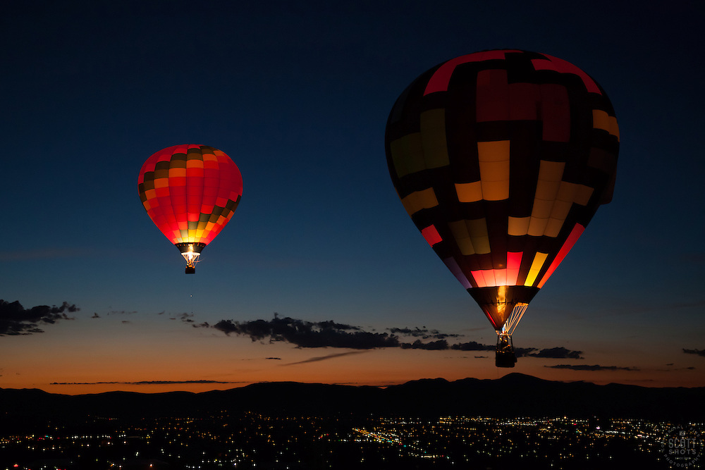 """Dawn Patrol 13"" - Photograph of a glowing hot air balloon flying for the Dawn Patrol at the 2012 Great Reno Balloon Race. Photographed from a hot air balloon."