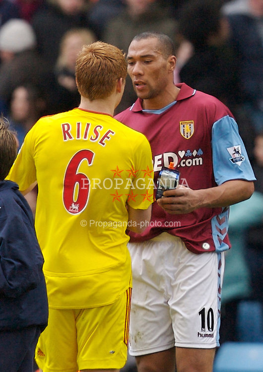 Birmingham, England - Sunday, March 3, 2007: Liverpool's John Arne Riise and Aston Villa's John Carew after the Premiership match at Villa Park. (Pic by David Rawcliffe/Propaganda)