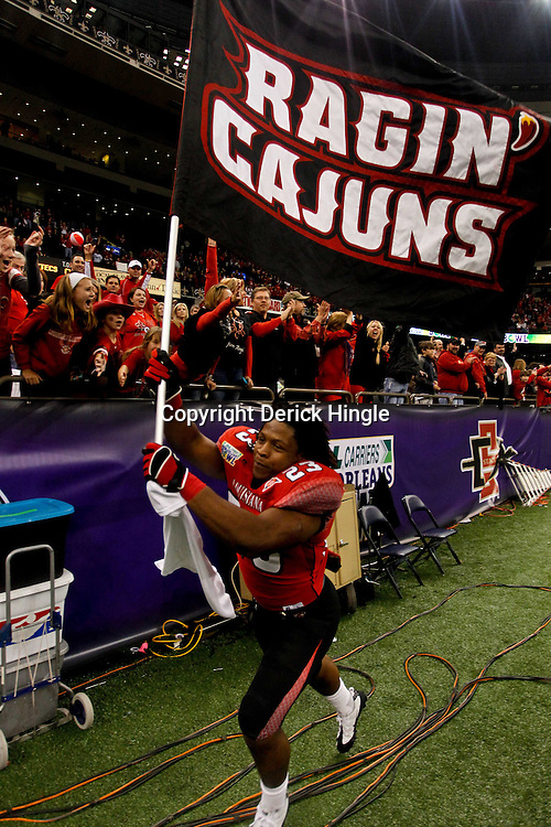 December 17, 2011; New Orleans, LA, USA;  Louisiana-Lafayette Ragin Cajuns running back Qyendarius Griffin (23) runs with a team flag following a win over the San Diego State Aztecs in the New Orleans Bowl at the Mercedes-Benz Superdome. Louisiana-Lafayette defeated San Diego State 32-30. Mandatory Credit: Derick E. Hingle-US PRESSWIRE