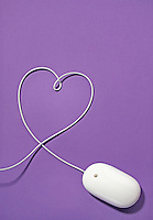 macintosh mouse with wire shaping a heart on purple