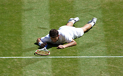 LONDON, ENGLAND - Friday, July 4, 2014: Grigor Dimitrov (BUL) falls over during the Gentlemen's Singles Semi-Final match on day eleven of the Wimbledon Lawn Tennis Championships at the All England Lawn Tennis and Croquet Club. (Pic by David Rawcliffe/Propaganda)