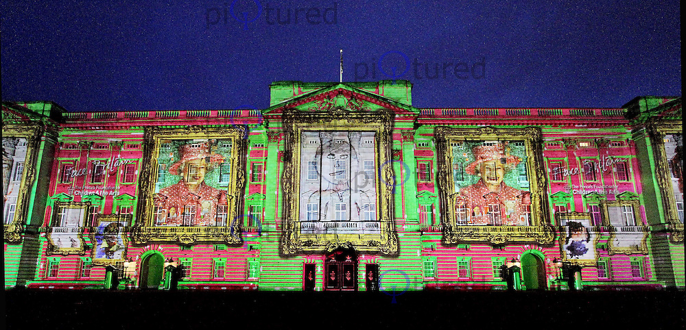 LONDON - APRIL 20: Face Britain, a light show of over 200,000 self portraits of children, is projected onto Buckingham Palace to form a montage image of Her Majesty the Queen, London, UK. April 20, 2012. (Photo by piQtured)