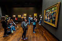 """Tourists admiring Renoir's """"Ball of the Moulin de la Galette"""", 1876,"""