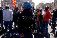 """Roma, 23 Marzo 2015<br /> Manifestazione di migranti richiedenti asilo che chiedono un  permesso di soggiorno umanitario per tutti, un'accoglienza dignitosa  e la possibilità di un lavoro per tutti e per dire «no allo sfruttamento e al business dell'accoglienza». La manifestazione è organizzata dal sindacato  Usb.La polizia blocca i migranti che volevano andare in corteo verso la prefettura. <br /> Rome, March 23, 2015<br /> Demonstration by asylum-seeking immigrants who they ask  a humanitarian residence permit for all , decent reception and the possibility of a job for everyone and say """"no to exploitation and to the business of hospitality."""" The protest  is organized by the union Usb. Police block migrants who wanted to go in marching  to the prefecture."""