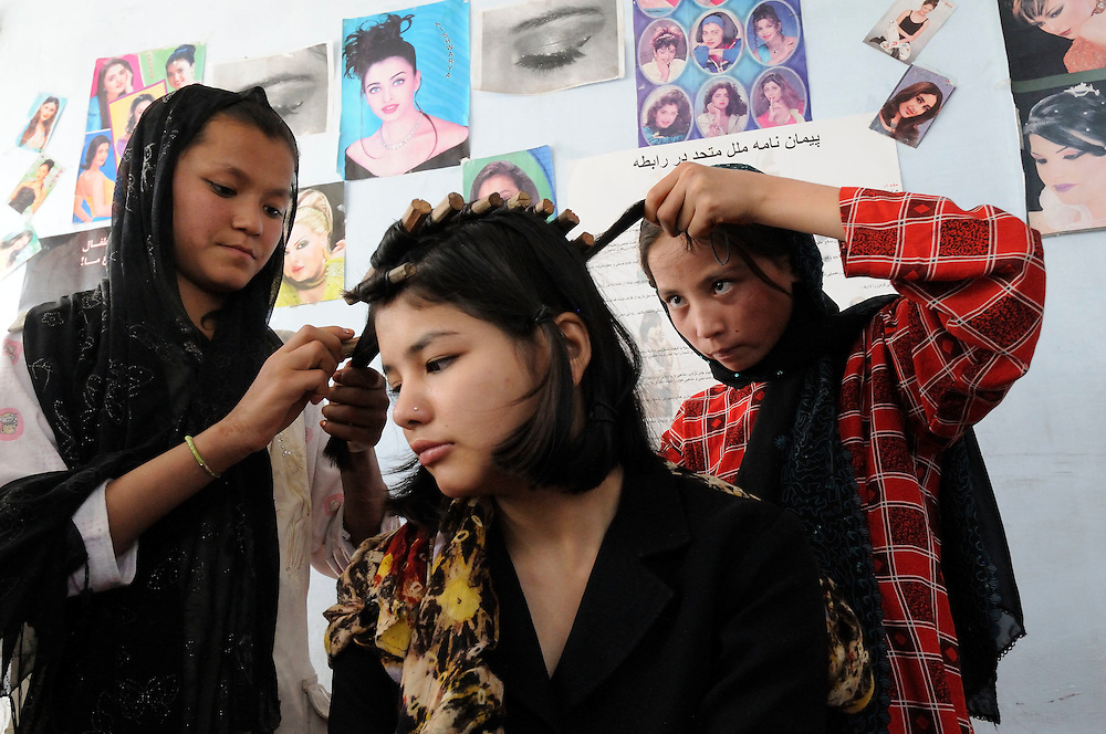 Aqila (right), age 13, together with her class mates learns beauty skills at Social Volunteers Foundation, Kabul, Afghanistan, on Thursday, October 9, 2008.  The project is supported by UNHCR.  Returnees and street children learn beauty, sewing, painting, flower making and other skills at the Foundation.