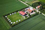 Nederland, Zeeland, Walcheren, 12-06-2009; Polder Walcheren, boeren camping, grasveld omgeven door windsingel van bomen, caravans met voortent in het gelid. .Nevenactiviteit van het boerenbedrijf, aanvullend inkomen voor de boer, zuinig op vakantie voor de kampeergast; lekker weg in eigen land. Air view on a camping on the farm.Swart collectie, luchtfoto (25 procent toeslag); Swart Collection, aerial photo (additional fee required).foto Siebe Swart / photo Siebe Swart