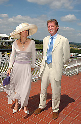 MRS NICKI STORMONTH-DARLING and MR STEVEN GODWIN-AUSTEN at the 4th day of the annual Glorious Goodwood horseracing festival held at Goodwood Racecourse, West Sussex on 30th July 2004.