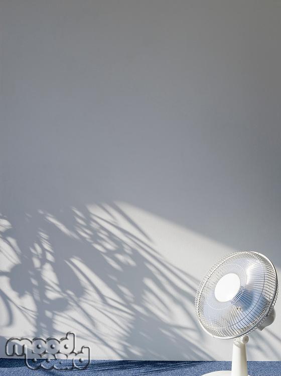 Electric fan in empty room